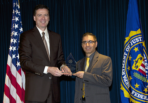 Director Comey and Dr. Muhammad Babar