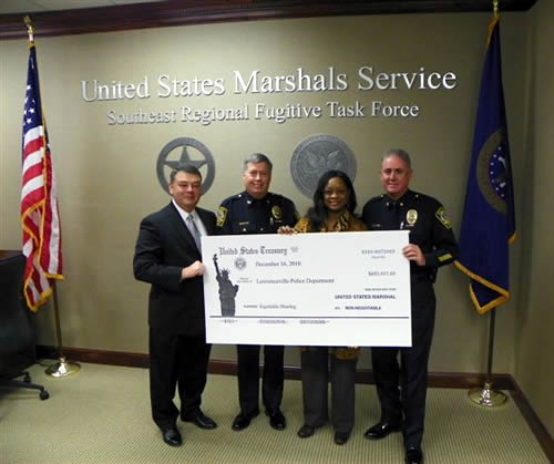 Atlanta Special Agent in Charge Brian D. Lamkin presents check to law enforcement partners (12/16/10)