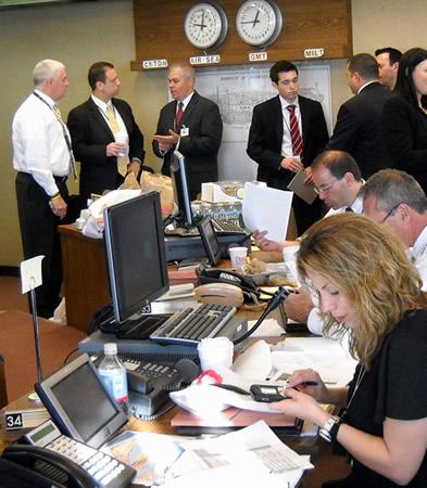 FBI personnel in command center during arrest operations  Photo Credit: Rich Kolko, FBI