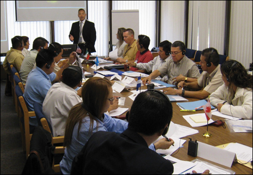 Members of the Central American Intelligence Program discuss issues at its inaugural meeting in July.