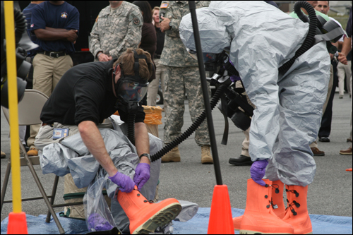 Personnel in protective suits