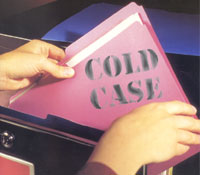 """Open file cabinet drawer with file with words """"Cold Case"""""""