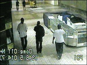 Three Jewelry Theft Ring Members Walking