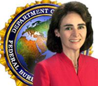 FBI Executive Maureen Baginski with Language Services seal in background