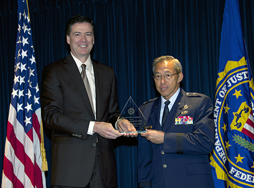 Director Comey and Major General Darryll D.M. Wong