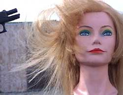 Figure 15 is a photograph of a shot causing a mannequin's hair to move.