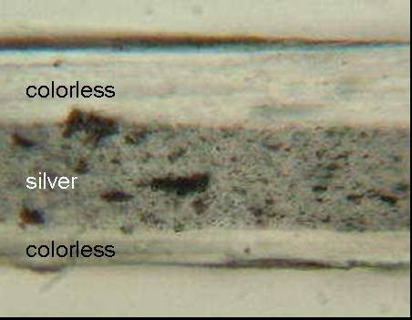 Figure 4 shows the micrograph of the cross section of tape Sample 81 magnified 250 times. The backing appears to have three layers.