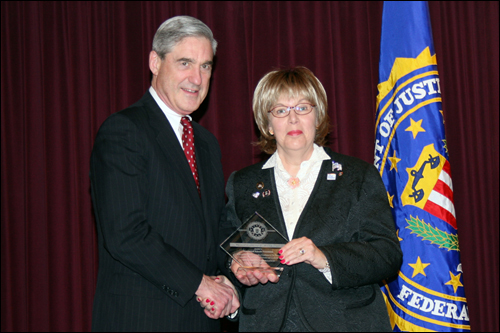 Director Mueller and Beverly A. Goldstein