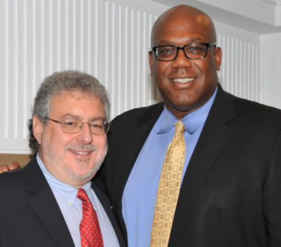 Special Agent in Charge Gerald Rose with a recent graduate of the Citizens' Academy during the reception.