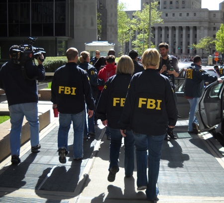 FBI agents heading to court outside the FBI New York Office. Photo Credit: SSA Richard Kolko, FBI