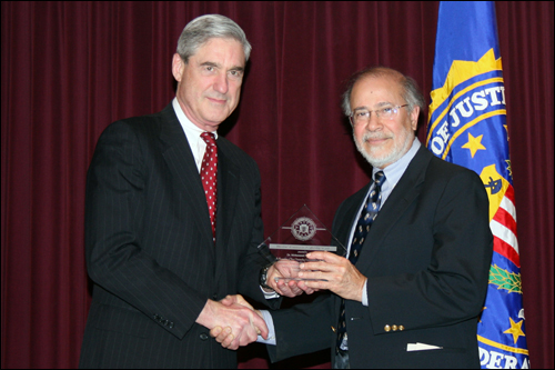Director Mueller and Dr. Mohammed Moinuddin