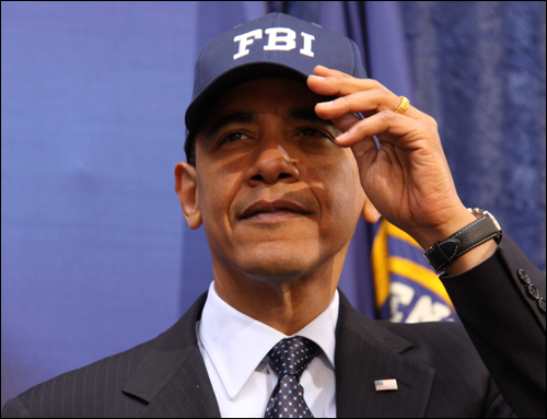 President Obama tries on his new FBI hat.
