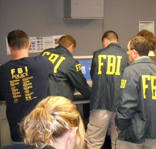 FBI personnel during processing, Photo Credit: J. Peter Donald, FBI