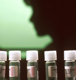 Human shadow behind glass vials