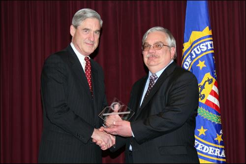Director Mueller and John Schunak
