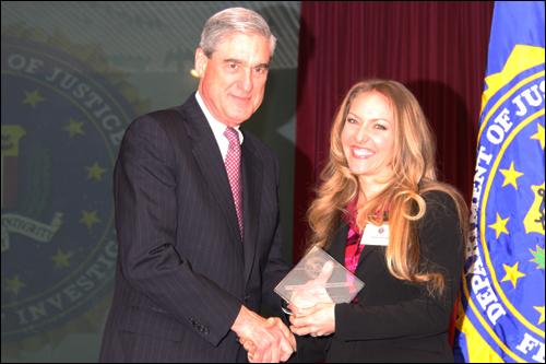 Director Mueller and Teresa Goines