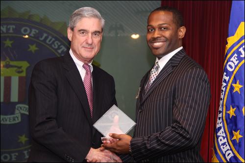 Director Mueller and Cedric D. Sparks, Sr.