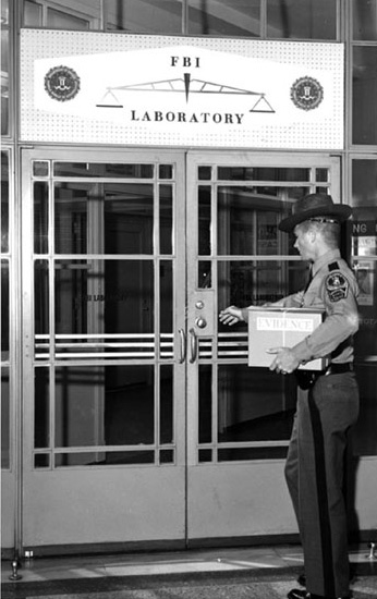 A historical photo of a Virginia State Police Officer delivering evidence to the Laboratory