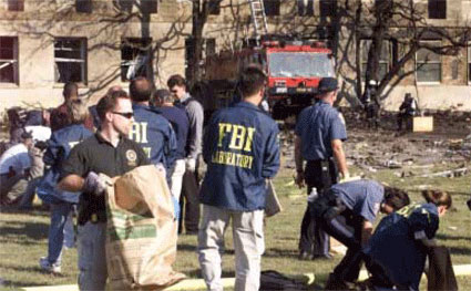 A photo of FBI Laboratory and other personnel collecting evidence at the Pentagon. (Source: Arlington County After-Action Report)