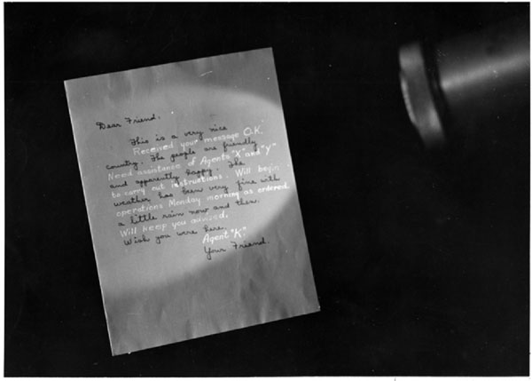 This historical photo shows how ultraviolet light can reveal hidden writing.