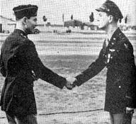 A historic handshake between two military men