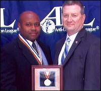 SSA Kendrick Williams and Los Angeles ADIC J. Stephen Tidwell