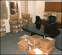 Investigators emerged from a 2002 search of Enron headquarters in Houston with more than 500 boxes of evidence.