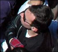 Vladimir Arutyunian in the crowd with a grenade