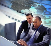 Two cyber agents at computer with map in background