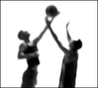 Basketball players in shadow