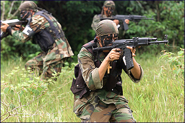 Paramilitary gunmen of the United Self-Defense Forces (AUC) during a training session in Colombia. Reuters photo.
