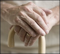 Elderly Person's Hands Holding a Cane