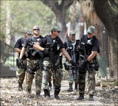 An FBI SWAT team assists local law enforcement in New Orleans in the days after Hurricane Katrina made landfall in August 2005