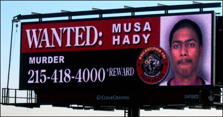 Going digital: thanks a partnership with Clear Channel Outdoor, FBI fugitives and missing pesrons will begin appearing on billboards like these in 20 cities nationwide.