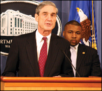 Director Robert S. Mueller was joined by civil rights leaders, including John H. Jackson, chief policy officer of the NAACP, at a press conference Tuesday at the Department of Justice in Washington, D.C.
