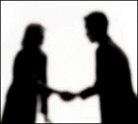 Male and female silhouettes shaking hands