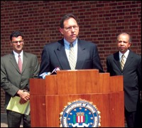 Philadelphia FBI Assistant Special Agent in Charge Brian Lynch is joined by Salam Al-Marayati, Executive Director MPAC, left, and Assistant U.S. Attorney Jeff Whitt during a May press conference in Philadelphia.