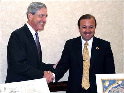 FBI Director Mueller with Joan Mesquida Ferrando (right), Director General of the Spanish National Police and Civil Guard.