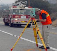 An FBI evidence expert surveys a scene in Orange County, California.