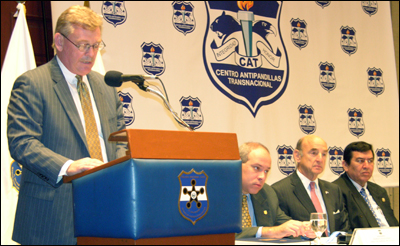Ken Kaiser, FBI Assistant Director for the Criminal Investigative Division, discusses a new anti-gang partnership in El Salvador in early October. Also attending the announcement was, from left to right, Rodrigo Avila Avilez, Director General of the Policia Nacional Civil; U.S. Ambassador to El Salvador Charles Louis Glazer; and Elizardo Gonzalez Lovo, Presidente de la Commission de Seguridad Publica y Combata al la Narcoactividad.
