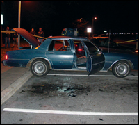 This blue 1990 Chevy Caprice was used as a rolling sniper's nest.