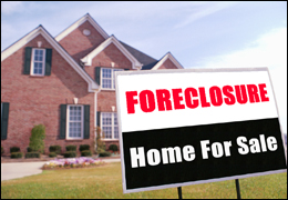 House with Foreclosure and Home for Sale Sign in Front