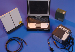 The Quick Capture Platform, which includes (left to right) the satelllite unit, laptop, battery, and fingerprint scanner