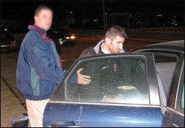 A Detroit FBI agent puts Albanian criminal Drini Brahimllari into a car after his February 2008 return to the U.S. to face racketeering charges in Michigan.