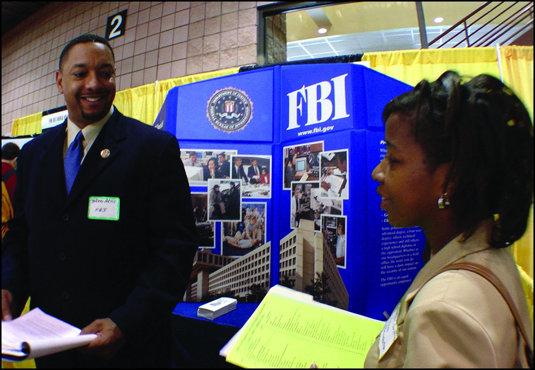 FBI Agent Recruiter Talks with Student at Career Fair