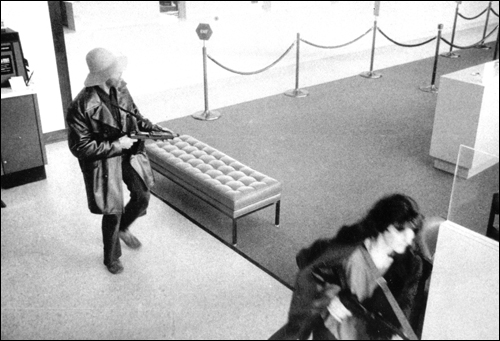 Patty Hearst and Donald DeFreeze robbing a San Francisco bank on April 15, 1974