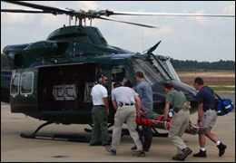 A team of FBI medics transport a Bureau employee in need of medical attention during an operational deployment.