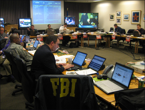 FBI special agents from the National Press Office helped field a flood of media calls on inauguration security in the U.S. Secret Service's Joint Information Center.