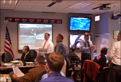 FBI agents and analysts and other Bureau partners in the command center.
