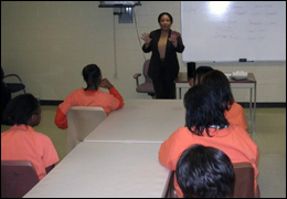 My Harrison, special agent in charge of the Memphis Field Office, speaks to young girls at the juvenile detention center in Memphis, Tennessee.